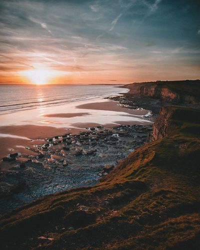 Southerndown sunset Beach Sea Sunset Sand Travel Dramatic Sky Horizon Over Water Outdoors Beauty In Nature Scenics No People Landscape Tide Wave Nature Water Sky Day Reflection Seaweed First Eyeem Photo The Great Outdoors - 2017 EyeEm Awards