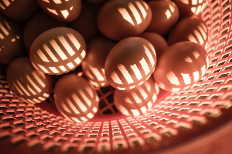 Egg in a Basket Chickens Reflection Shadow Light And Shadow Sunlight Ray Egg Close-up No People Indoors  Pattern Still Life Backgrounds Selective Focus Food Basket Full Frame High Angle View Shape Brown