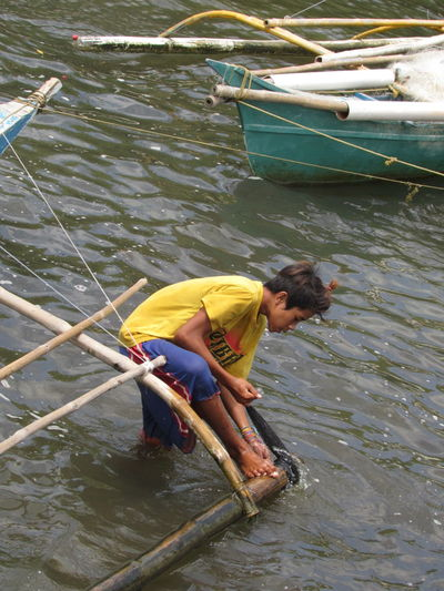 Water One Person Full Length Day Fishing Net People River Outdoors Adults Only Fisherman Adult Side View Only Men Fishing Working Real People One Man Only Nautical Vessel Standing Men Inspirations Sea Port Village Close-up Travel Destinations Miles Away