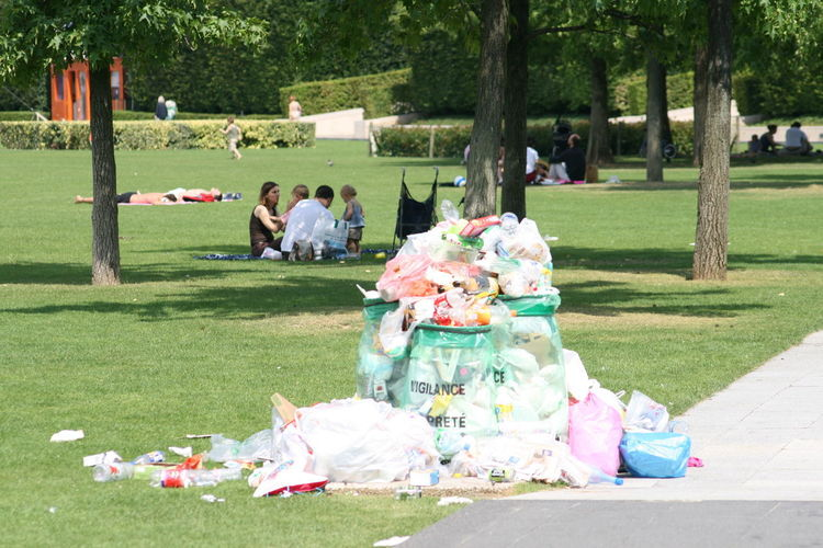Group of people on garbage outdoors