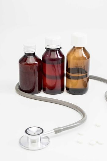 Bottle of medicine Healthcare And Medicine Bottle Container Medicine Studio Shot White Background Indoors  Glass - Material Medical Equipment No People Pill Group Of Objects Choice Close-up Transparent Variation Science Still Life Medical Supplies Medical Instrument