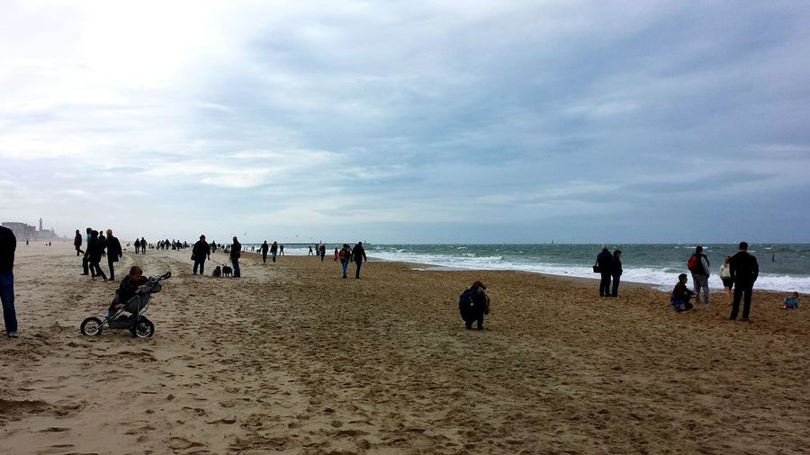Large Group Of People On Sandy Beach Cold Temperature