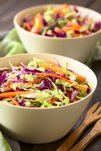 Fresh coleslaw, a salad made of shredded red and white cabbage and carrots, served in white bowls, photographed with natural light (Selective Focus, Focus in the middle of the salad) Cole Slaw Homemade Raw Red Red Cabbage Vegetarian Vegetarian Food White Cabbage Cabbage Carrot Chopped Coleslaw Cruciferous Food Food And Drink Fresh Healthy Healthy Eating Raw Food Salad Shredded Vegan Vegetable Vegetarian Food White