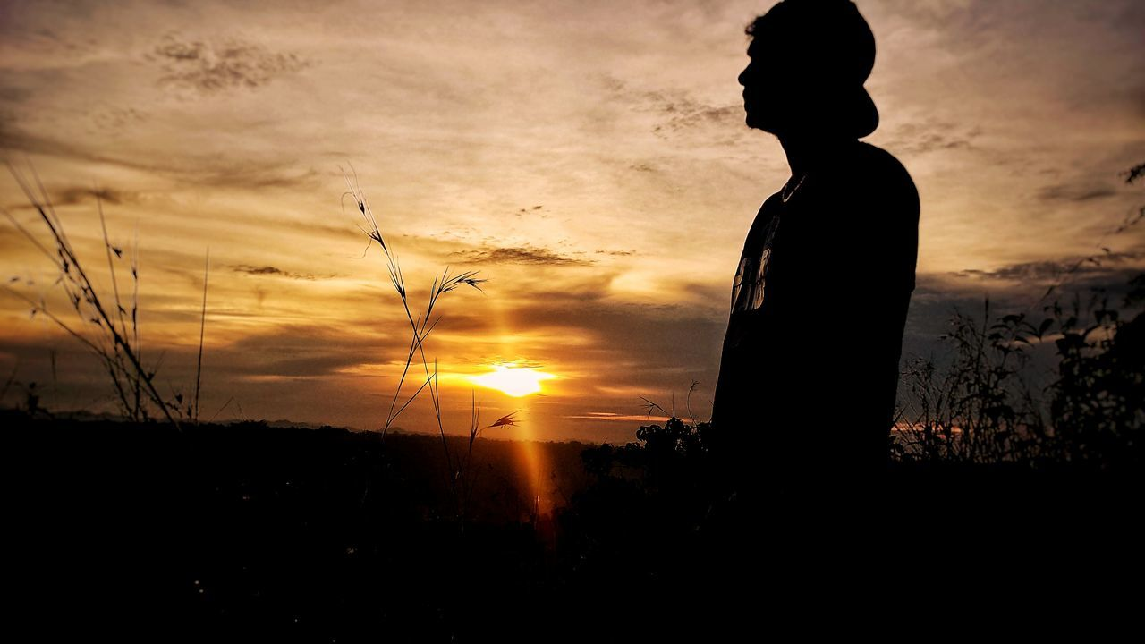 sunset, silhouette, sun, nature, sky, cloud - sky, one person, outdoors, tranquil scene, beauty in nature, scenics, tranquility, real people, standing, day, people