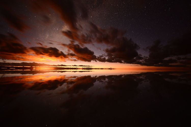 Somewhere where this is not here, Uyuni salt flat, Bolivia Astronomy Beauty In Nature Cloud - Sky Constellation Dawn Dramatic Sky Galaxy Idyllic Lake Majestic Nature Night No People Outdoors Reflection Scenics Sky Star - Space Sunrise Tranquil Scene Tranquility Water Waterfront