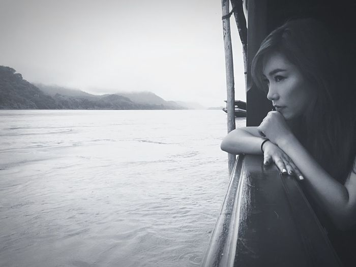 EyeEm Selects Mode Of Transport Young Adult Transportation Real People Young Women One Person Day Side View Beautiful Woman Outdoors Lifestyles Water Nature Nautical Vessel Mountain Clear Sky Sky People mekongriver Nature Loas Mekong River Relaxing
