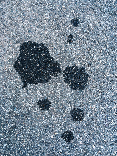 Oil stains. New Jersey, USA. Photo by Tom Bland. Abstract Asphalt Backgrounds Detail Gasoline Graphic Ground IPhone IPhoneography Looking Down Minimal Minimalism Oil Oil Industry Petrol Pollution Pollution In My World Road Stain Stains And Cracks Street Tarmac Texture Textured  Urban