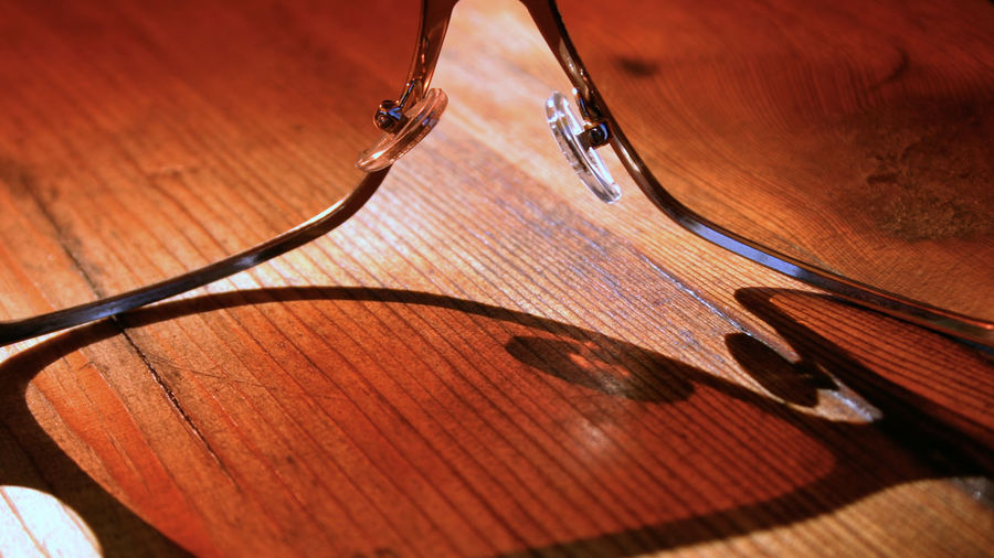 Close up sunglasses on the wooden surface with shadow under sunlight Bright Holiday Lights Sunlight Wood Background Close-up Clothing Eye-wear Eyeglasses  Frame Sunglases Surface Texture Ultraviolet Wooden Wooden Surface first eyeem photo