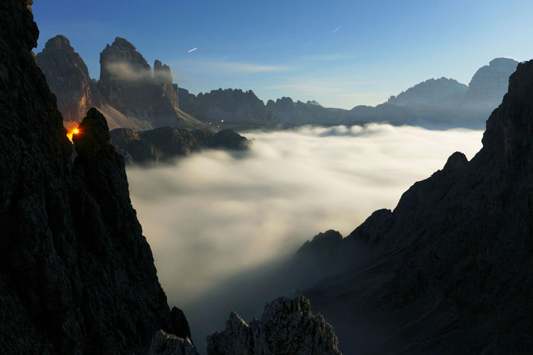Scenic View Of Cloudscape Amidst Rocky Mountains Against Sky