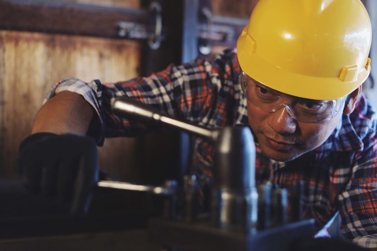 Midsection of man working in kitchen