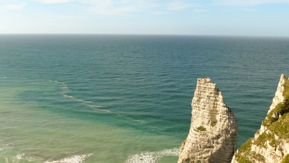 Etretat Water Sea Scenics - Nature Horizon Beauty In Nature Horizon Over Water Sky Tranquility Nature Tranquil Scene Day No People Idyllic Land Beach Seascape Outdoors Blue Motion Turquoise Colored étretat Etretat Cliffs Normandie Travel Destinations High Angle View