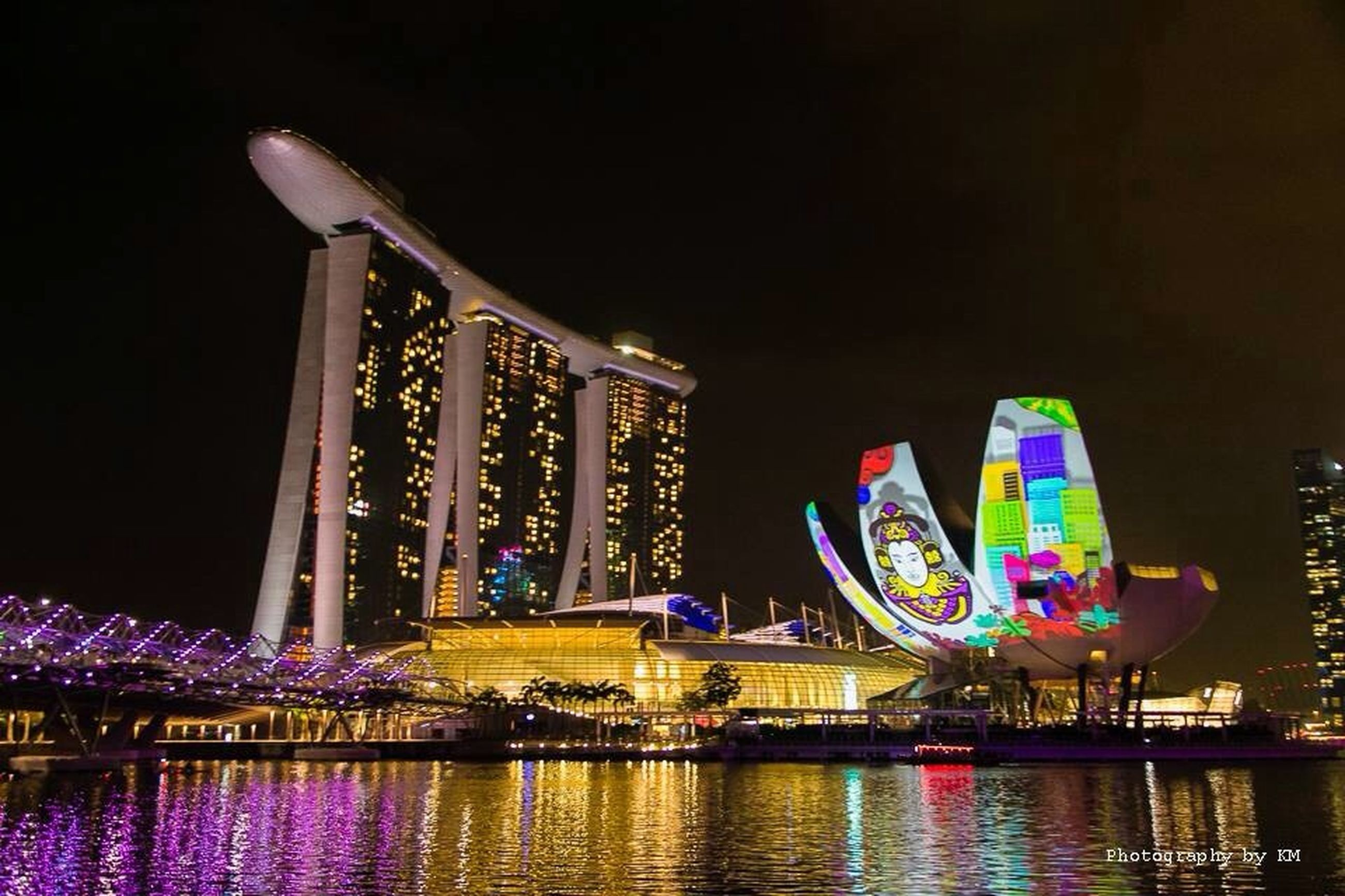 illuminated, night, water, built structure, reflection, architecture, waterfront, multi colored, building exterior, river, blue, lighting equipment, outdoors, no people, light - natural phenomenon, sky, light, decoration, arts culture and entertainment, clear sky