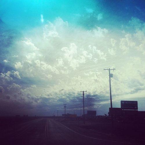 Road Arizona AZ Holbrook jimgrays jimgraysgiftshop petrifiedforest petrifiedwood clouds weather dusty windy