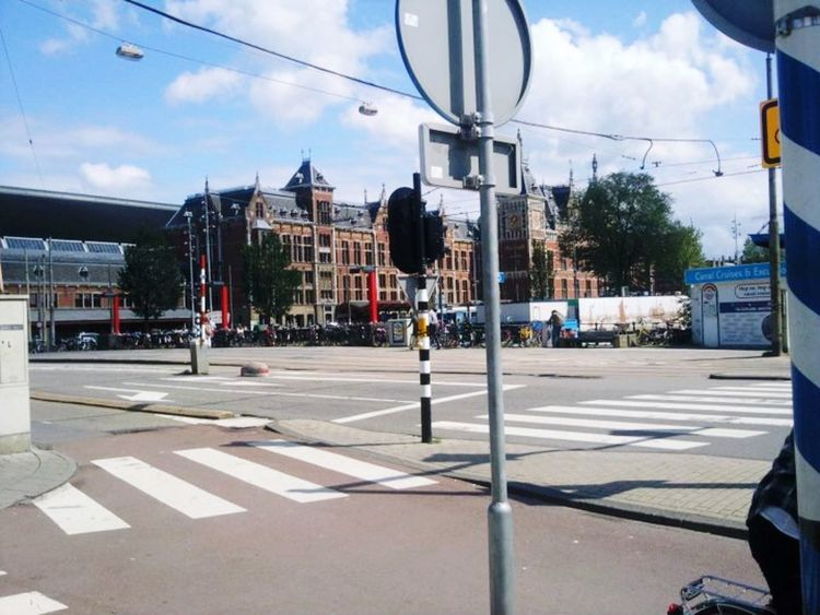 City Life Break Away Tourism Destination Pedestrian Crossing Signs Road Buildings Architecture Transportation Day Street Cloud - Sky Outdoors Road Sign Streetphotography Amsterdam Your Ticket To Europe Gridlove
