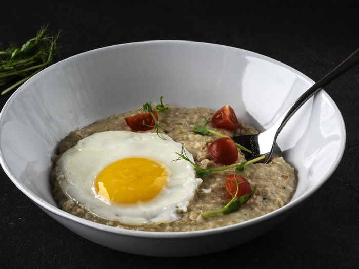 Parmesan Oatmeal and Scrambled Eggs Parmesan Oatmeal Scrambled Eggs Egg Food And Drink Food Healthy Eating Ready-to-eat Freshness Fried Fried Egg Wellbeing Indoors  Breakfast Meal Close-up Egg Yolk No People Vegetable Table Sunny Side Up Kitchen Utensil Bowl Eating Utensil Crockery