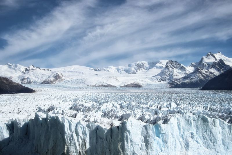 Scenic view of snowcapped mountains and glacier against sky