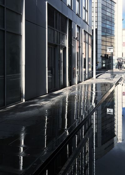 Reflection of buildings on wet glass window
