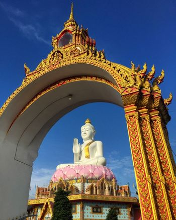 White image of Buddha and the golden gate Buddha Buddha Statue Buddhist Image Religion Spirituality Statue Sculpture Low Angle View Place Of Worship Architecture Built Structure Gold Colored Human Representation Ornate Building Exterior Day No People Outdoors Sky EyeEmNewHere An Eye For Travel