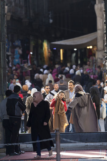 Crowd at the entrance to the umayyad mosque, damascus