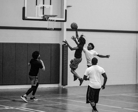 Basketball - Sport Court Basketball Player Sport Basketball Hoop Ball Full Length Sports Clothing Dribbling Competitive Sport Playing Real People Sports Uniform Physical Education Practicing Indoors  Team Sport Sports Team Motion