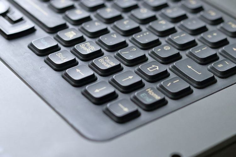 Backgrounds Black Color Business Calculator Close-up Corporate Business Equipment Finance Gray Indoors  Keypad Laptop Laptop Keyboard Mathematics No People Number Office Plus Sign Selective Focus Silver Colored Single Object Symbol Table Technology