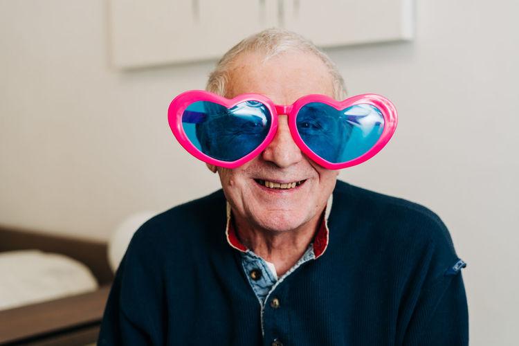 Portrait of smiling man wearing mask
