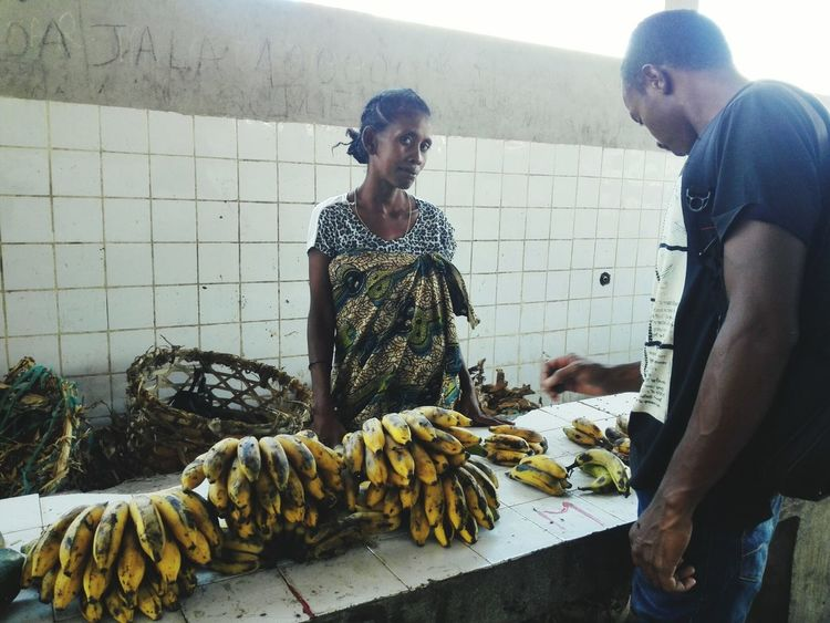 Food Stories Banana Fruit People And Places. Market Fruit Adult Seller And The Buyer Two People