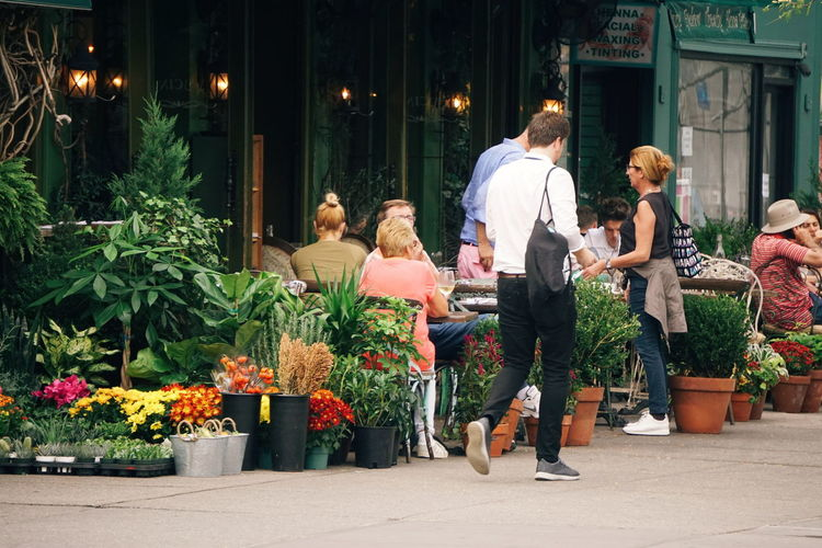 People At Outdoor Restaurant In City