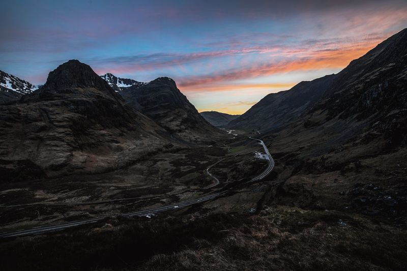 Afterglow Glencoe Beauty In Nature Glencoe Scotland Landscape Mountain Mountain Peak Mountain Range Mountain Road Nature No People Remote Road Scenics - Nature Sunset The Three Sisters