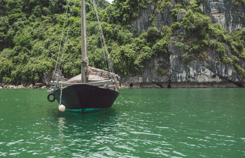 Nautical Vessel On Halong Bay By Mountain