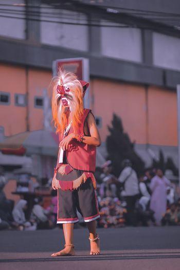 Full length of man wearing mask on street