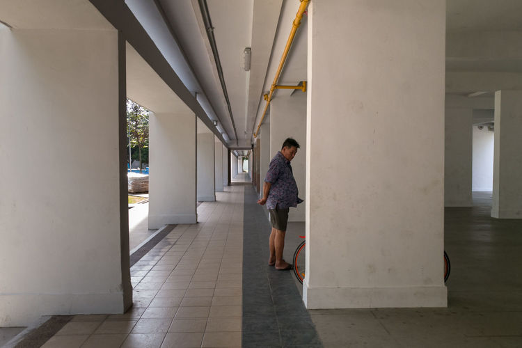 Man walking in corridor
