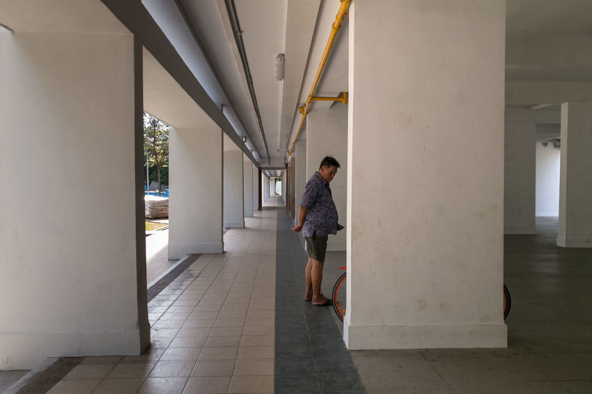 One Person Mature Adult Corridor Standing Void Deck Housing Estate Residential  Asian  Man Random Uncle Bedok Rainbow Ville Singapore HDB Mobile Photography Street Photography Streetphotography Streetphoto_color HuaweiP9
