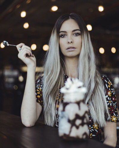 Milkshake Portrait, mid angle, low depth of field. One Person Real People Portrait Young Women Long Hair Young Adult Front View Leisure Activity Hair Hairstyle Headshot Lifestyles Focus On Foreground Illuminated Women Looking At Camera Beautiful Woman Beauty Contemplation Teenager