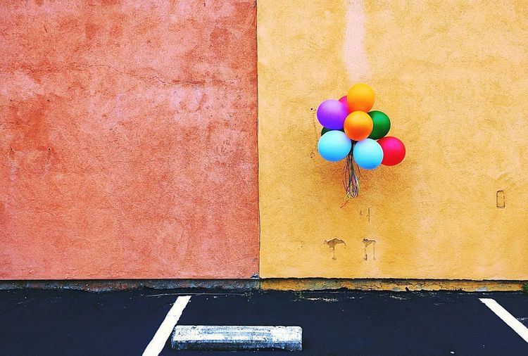 Colorful balloons hanging on wall