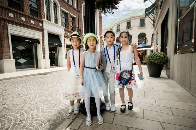 Chinese children on Rodeo Drive, Beverly Hills Chinese Children Chinese Children Cute Rodeo Drive Building Exterior Child Childhood Children Shoppin Cute Children Cute Innocent Children Friendship Full Length Group Of People Looking At Camera People Portrait Smiling Togetherness Wealthy Children