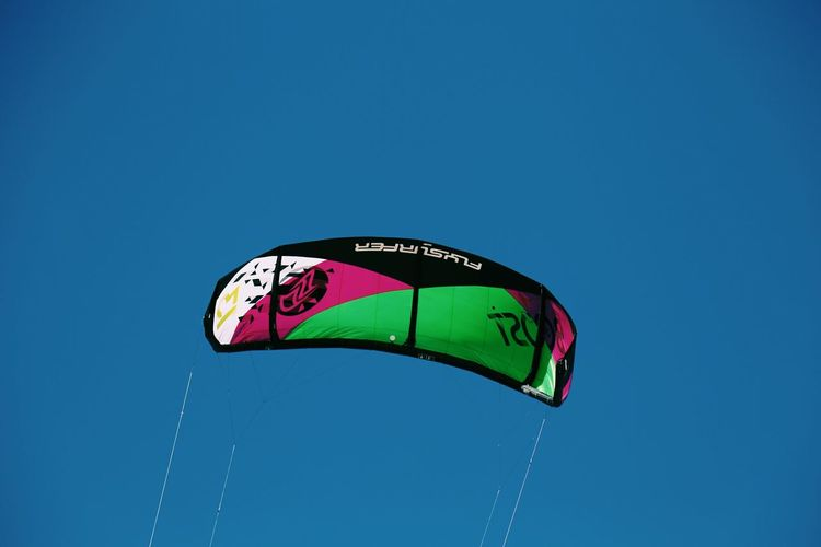 Mid-air Leisure Activity Motion Flying Extreme Sports Clear Sky Kite Kitesurfing Beach The Weekend On EyeEm Nature Adventure Outdoors Sky Wind Sport Blue Blue Sky