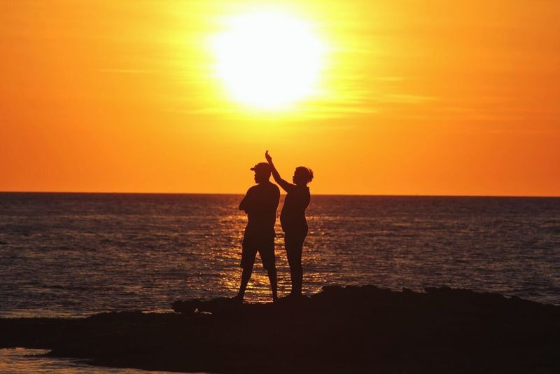 Abies. Sunset Sea Sun Horizon Over Water Orange Color Two People Beauty In Nature Nature Standing Water Scenics Togetherness Sunlight Real People Silhouette Beach Leisure Activity Tranquil Scene Sky Full Length