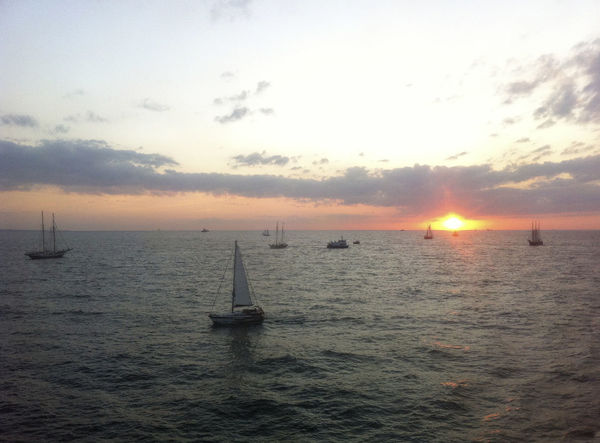 Beauty In Nature Boats Day Horizon Over Water Nature Nautical Vessel No People Outdoors Sailboat Sailing Scenics Sea Shipping  Ships Sky Sun Sunlight Sunset Tranquil Scene Tranquility Water Waterfront