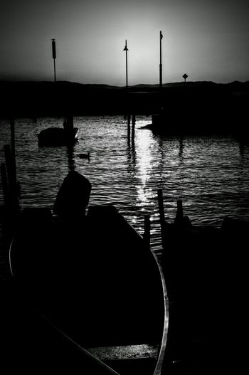 Silhouette Water Reflection Sunset Real People Sea Sky Men Nature Scenics One Person Outdoors Beauty In Nature Adult Day People Human Body Part Trasimenolake