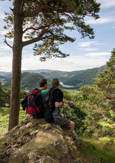 Admiring the view towards Thirlmere, hikers on High Rigg, Cumbria Backs Beauty In Nature Hikers Lake District Landscape Leisure Activity Lifestyles Looking At View Mountain Nature Outdoors Relaxation Resting Scenic View Sitting Thirlmere Tranquil Scene Two Men View Walking