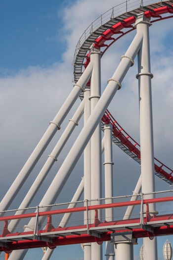 Roller Coaster Alloy Amusement Park Amusement Park Ride Architecture Arts Culture And Entertainment Blue Built Structure Cloud - Sky Day Industrial Equipment Low Angle View Metal Nature No People Outdoor Play Equipment Outdoors Pattern Red Rollercoaster Sky Steel Tourism Travel Travel Destinations
