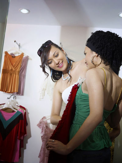 shopping at clothing store Asian  Business Fashion Free Time Happiness Shopping Clothing Clothing Store Discount Enjoying Life Female Fitting Room Fun Time Garment Leisure Activity Lifestyles Real People Sales Shopping Mall Smiling Two People Weekend Activities Women Young Women