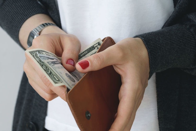 Economy Finance Girl Money Purse Investing In Quality Of Life Business Stories