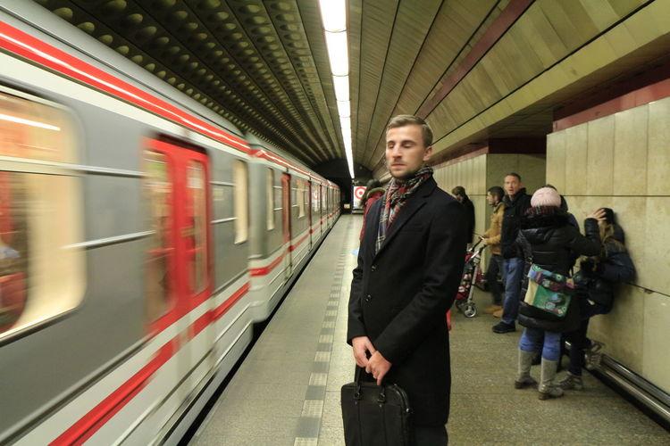 People Waiting For Train At Subway Platform