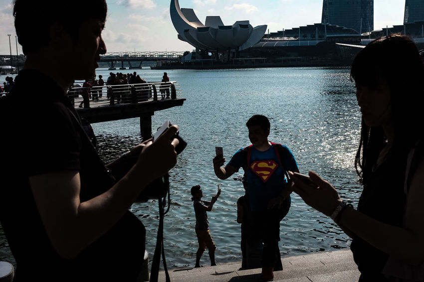 Man Of Steel Superman Selfie Tourists People Water Outdoors Silhouette Street Photography Streetphotography Streetphoto_color Street Life Everybodystreet FUJIFILM X100S The City Light