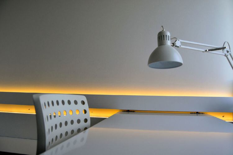 Desk Office Close-up Communication Copy Space Electric Lamp Electrical Equipment Electricity  Illuminated In A Row Indoors  Interior Design Lamp Light Metal Minimalism No People Number Still Life Technology Wall - Building Feature White Color
