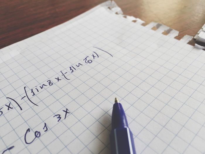 Close-up of mathematical equation on paper