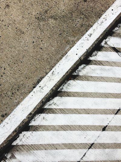 Road Marking Copy Space Separation Separated Close-up Outdoors No People Day High Angle View Urban Geometry Sidewalk Pavement Pavement Patterns Parallel Lines White Lines Concrete Diagonal Lines Keepout Barred Area No Parking Background Textures And Surfaces