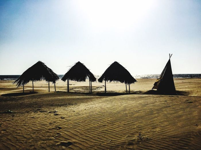 Beach Sand Sea Tranquility Outdoors Clear Sky Nature Day No People Tranquil Scene Water Thatched Roof Sky Scenics Vacations Beauty In Nature Shade Tent Beachphotography Beach Life Vacation Relaxing Silhouette The Week On EyeEm